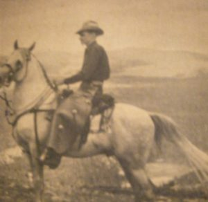 Man on horse in old photo