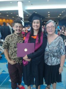 Graduation with brother and grandma