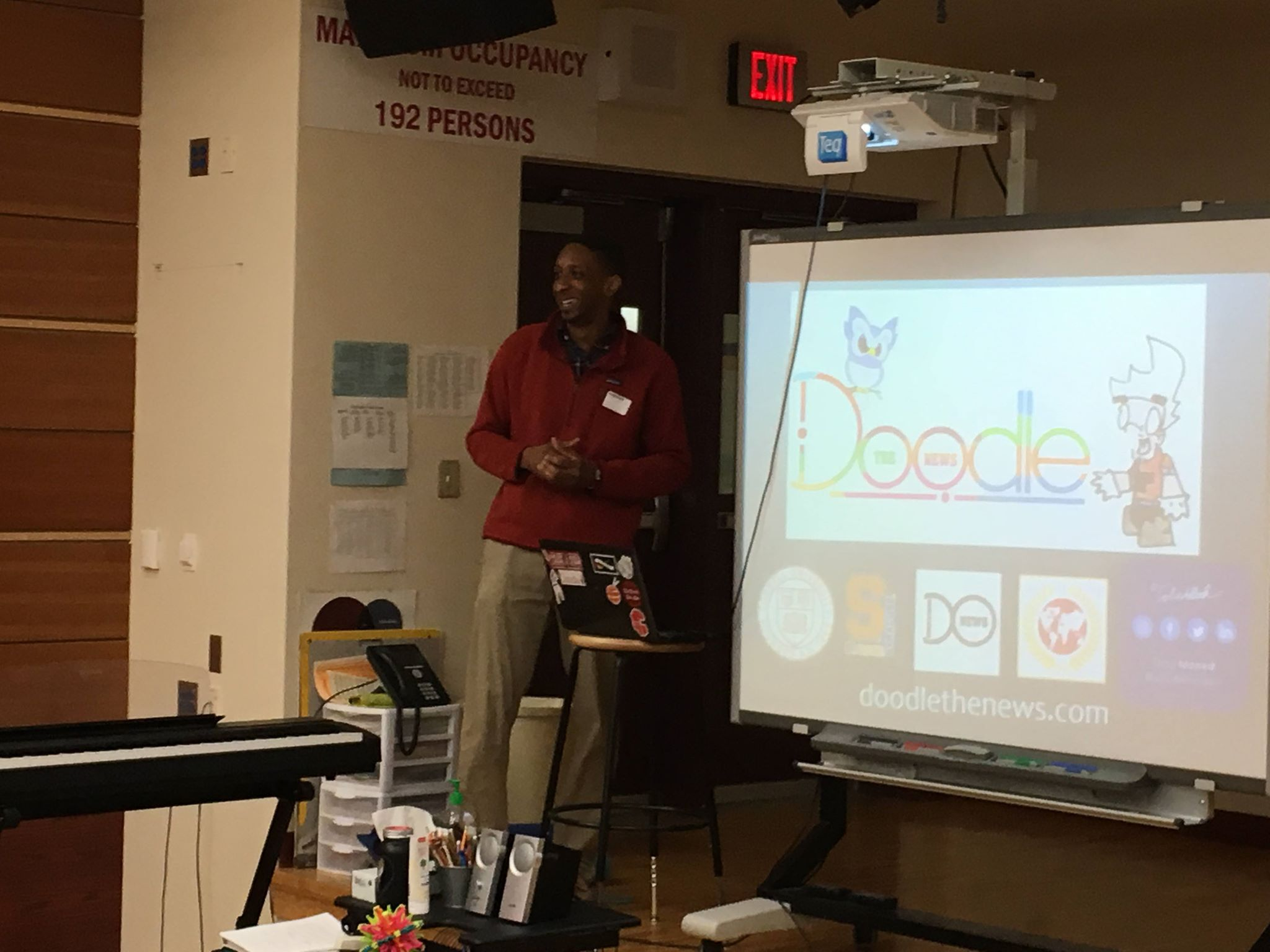 Tobe giving a presentation to students