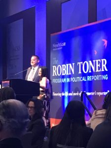 Two people at a podium at the Robin Toner awards