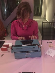 Typing a haiku on a typewriter for me at Newseum Nights in Bloom
