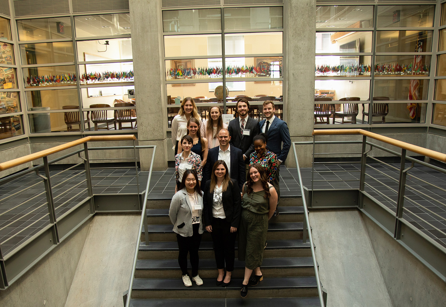 Ben Rhodes poses with Public Diplomacy students for group photo