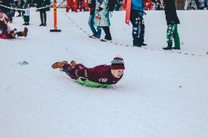 Man sledding down a hill.