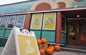 Outdoor sign and main door of Syracuse Co-Op
